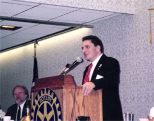 Dr. Lamont Colucci speaking at Rotary, Int'l